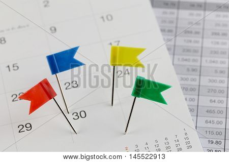 Pins to Wildcats on the calendar beside the number of thirty in business concept time and date.