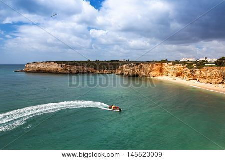 Speedboat at sea view from above. Algarve Portugal Armacao de Pera