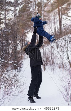 Father abandoning his child in a winter forest.