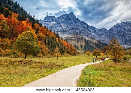 Path through autumn mountain landscape in the Alps Engalm Austria Tirol.