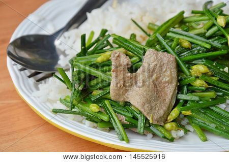 stir fried garlic chives with pork liver on rice