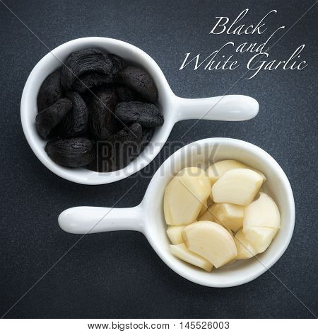 Square macro image of Black and white Garlic in small white pots on a grey slate base with wording. ideal for pinterest