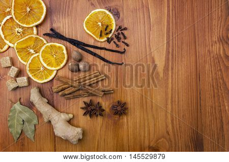 Selection of christmas spices on wood background top view