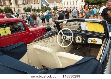 TISNOV, CZECH REPUBLIC - SEPTEMBER 3, 2016:  The traditional meeting of fans of vintage cars and motorbikes. An exhibition of old cars in the town square of Tisnov. Detail of veteran cars