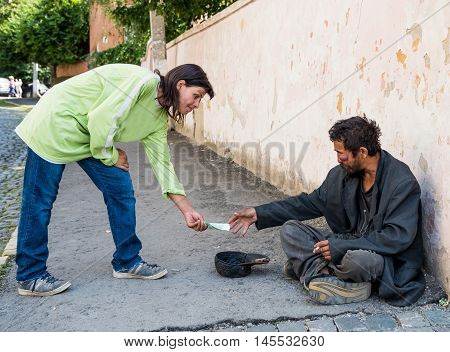 Uzhhorod, Ukraine -  August 21, 2016: Poor Man Begging For Alms Near The Church