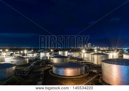 Oil tank industrial night landcape for background