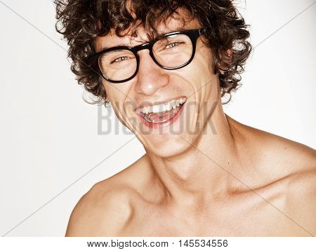 Emotional portrait of a pretty young man on white background