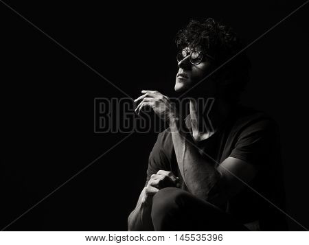 Emotional black and white dramatic portrait of a pretty young man