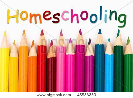 Pencil Crayons with text Homeschooling isolated over white