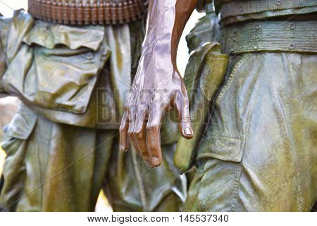 Washington DC, DECEMBER 19, 2015: Vietnam Veterans Memorial, this is the bronze statue at entrance.