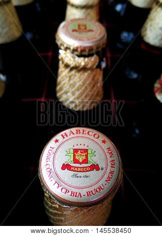 Hanoi, Vietnam - Sep 8, 2016: Close up of bottles of Hanoi Beer in a cart in Hanoi street. Hanoi Beer is a beer brand produced in Hanoi, Vietnam. It is a trademark of Habeco Join Stock Company.
