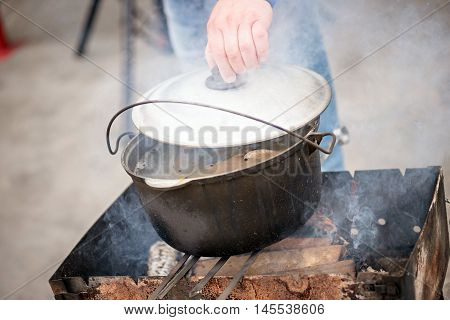 fish soup on the fire on barbecue. chowder