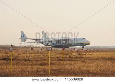Kiev Region Ukraine - January 5 2012: Antonov Design Bureau An-225 Mriya is taxiing to runway for takeoff on sunset