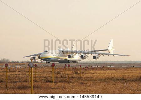 Kiev Region Ukraine - January 5 2012: Antonov Design Bureau An-225 Mriya is taxiing to takeoff on sunset