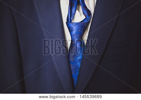 Blue suit, white shirt and blue tie. Business, financial or politic concept