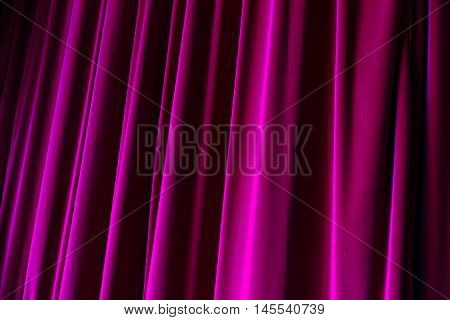 Purple drop curtain hanging down on a stage
