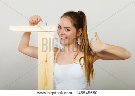 Success Ful Woman Assembling Furniture. Diy.