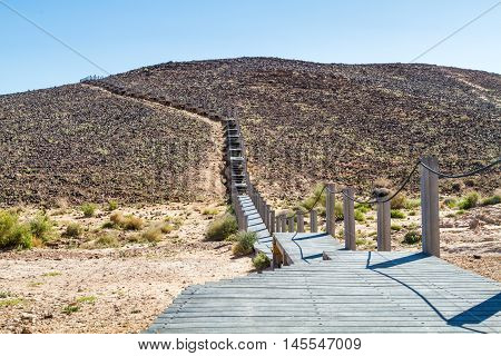 The Ramon Crater stairs on the hill in Makhtesh Ramon nature reserve in Negev desert Israel