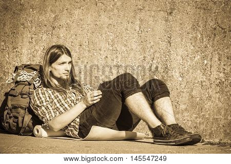Man Tourist Backpacker Sitting With Tablet Outdoor