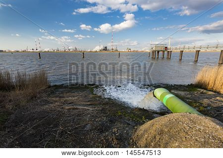 Wastewater Pipe And Refinery At River