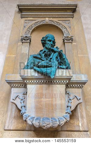 Giuseppe Tartini statue on an ancient building in Italy