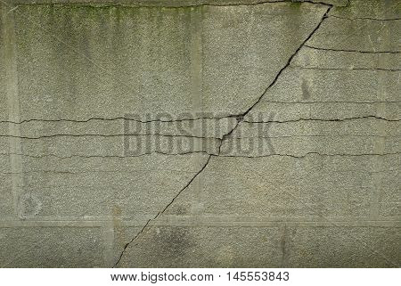 Pronounced crack in a wall running diagonally. Old cracked texture. Concrete pattern with one crack