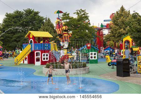 GUNZBURG GERMANY - AUG 18 2016: Children playing in a fountain at the Lego themed park Legoland Deutschland in Guenzburg Baden Wurtemberg Germany