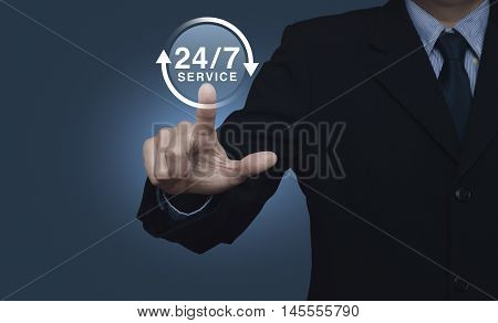 Businessman pressing button 24 hours service icon on blue background Full time service concept