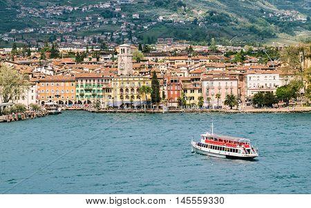 Riva del Garda Italy - April 15 2016: The town of Riva del Garda seen from the lake.