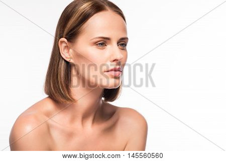 Natural. Wistful young woman face close up portrait on isolated white background