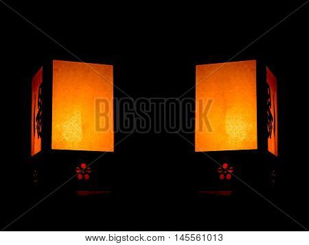 Traditional paper lanterns on the black background