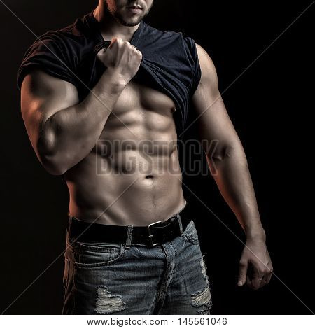 Muscular Man With Shirt On Shoulder