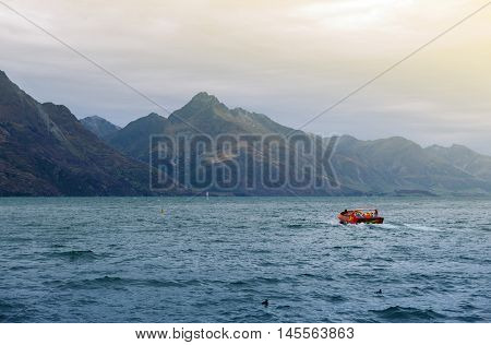 Queenstown New Zealand - March 2016: Lake Wakatipu Queenstown south island of New Zealand with a speed jet boat seen from distant