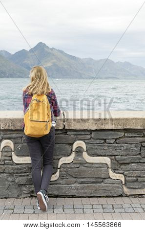 Queenstown New Zealand - March 2016: Tourist enjoying spectacular view of Lake Wakatipu at Queenstown waterfront New Zealand