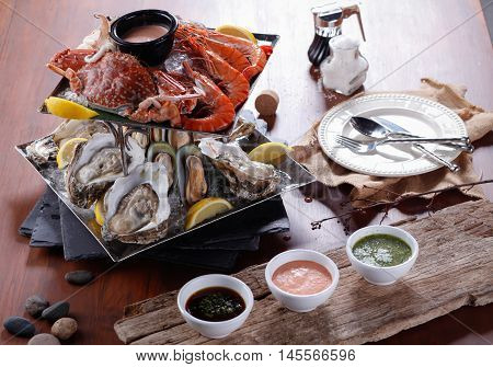 Seafood Plate of crustacean seafood with fresh lobster mussels oysters on dining table