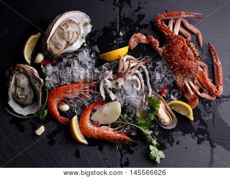 Fresh Seafood Crab Shrimp Oyster on stone background