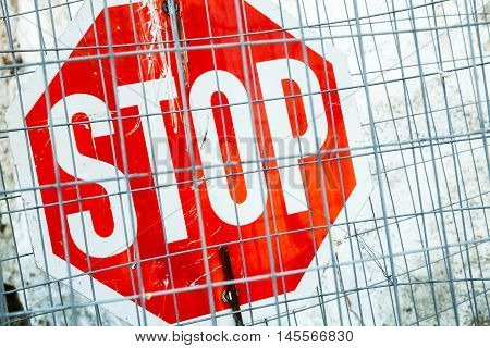 Red Stop Road Sign With Metal Grilles