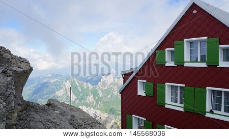 A part of the mountain house on the Saentis and mountains and valleys of the Alpstein-Massif in Switzerland