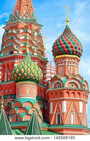 The most famous architectural place for visiting and attraction in Moscow Russia Saint Basil's cathedral with colorful cupolas and spectacular domes in traditional culture on cloudy blue sky
