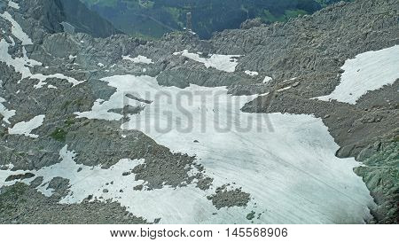 Hikers on a large snowfield are accident in the Alpstein-massif in the Switzerland, landscape in the high mountains