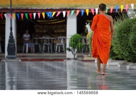 Bangkok (Thailand) Buddhist Monk walking barefoot in a temple
