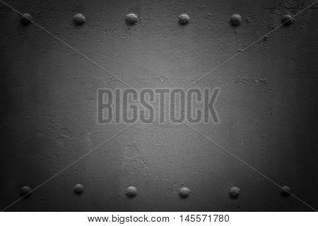 Riveted industrial plate. Metal background. Black .