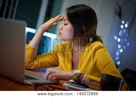 Girl College Student With Headache Studying At Night