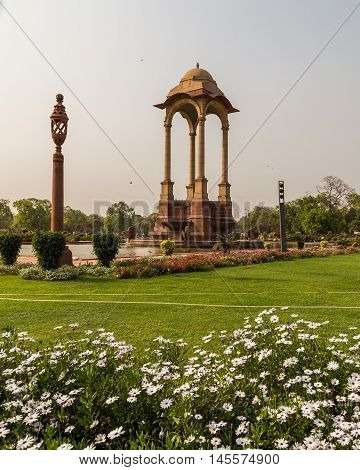 DELHI INDIA - 19TH MARCH 2016: The Canopy and India Gate in Delhi during the day. People can be seen.