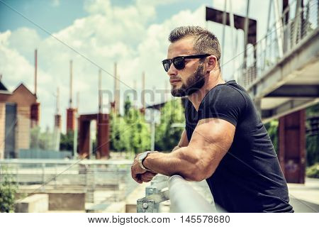 Handsome Muscular Hunk Man Outdoor in City Setting. Showing Healthy Body While Looking Away