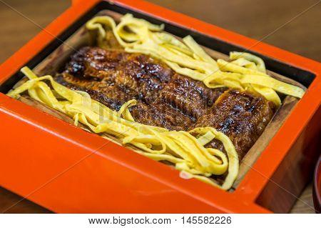Close Up Unagi Don - Grill Eel Rice In Red Box .