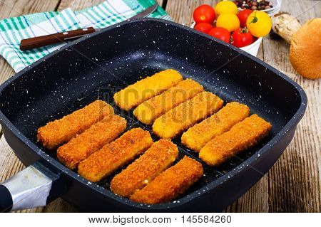 Fish sticks breaded Studio Photo on Pan