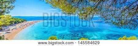 Famous adriatic beach Golden Horn (Zlatni Rat) in Bol, Island of Brac, Croatia summertime panorama.