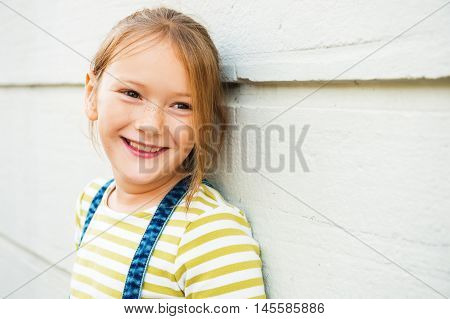 Close up portrait of adorable young 8 years old