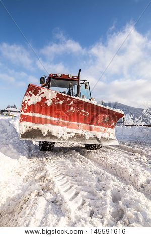 Big snow plow machine ready for action
